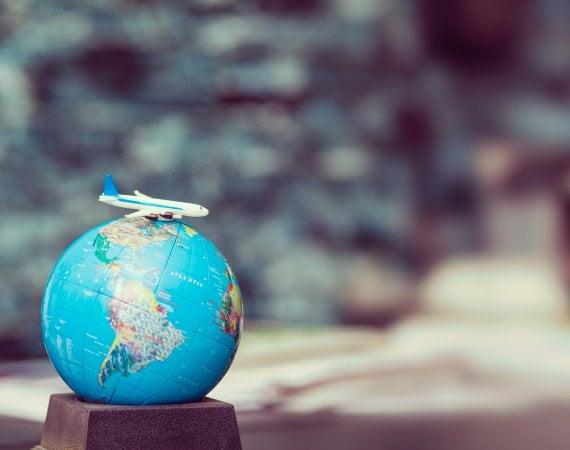 selective focus photo of desk globe